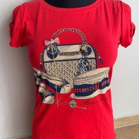 419f527ca549 Dámské tričko Vogue